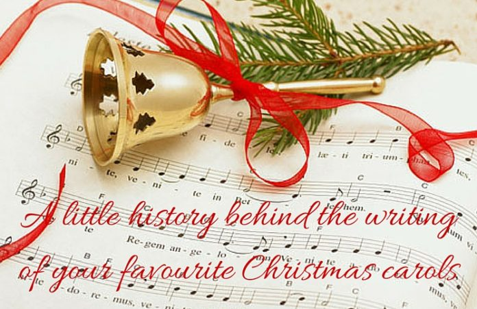 christmas carol manuscript paper and bells