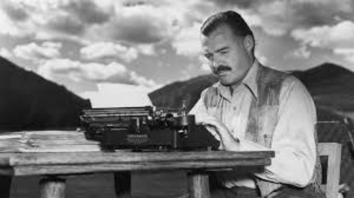 hemingway with typewriter in nature