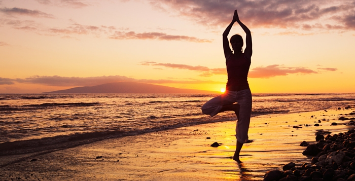 person meditation on the beach at sunset in treepose
